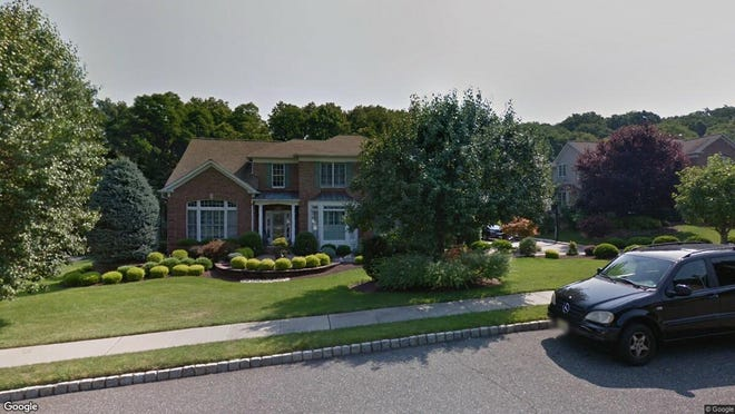 This Google Street View image shows the approximate location of 18 Crimson King Drive in Holmdel. The property at this address changed hands in November 2019, when new owners bought the property for $970,000.