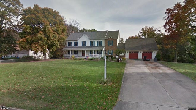 This Google Street View image shows the approximate location of 18 Lodge Road in East Greenwich. The property at this address changed hands in August 2019, when new owners bought the property for $426,000.