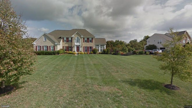 This Google Street View image shows the approximate location of 114 Quail Ridge Way in East Greenwich. The property at this address changed hands in August 2019, when new owners bought the property for $495,000.