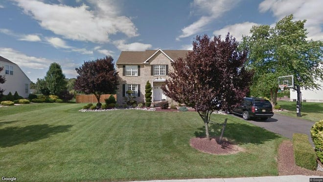 This Google Street View image shows the approximate location of 880 Oakley Drive in Freehold Township. The property at this address changed hands in December 2019, when new owners bought the property for $735,000.