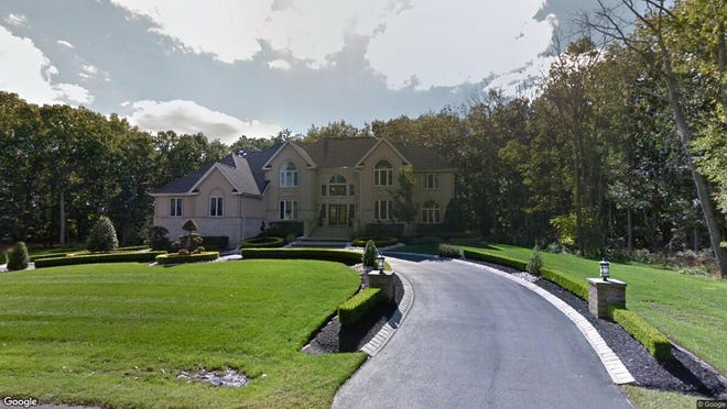 This Google Street View image shows the approximate location of 20 Partners Lane in Freehold Township. The property at this address changed hands in November 2019, when new owners bought the property for $1,350,000.