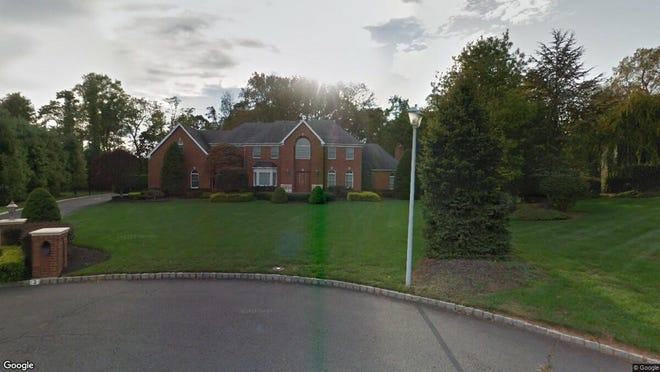 This Google Street View image shows the approximate location of 2 White Cedar Lane in Holmdel. The property at this address changed hands in November 2019, when new owners bought the property for $999,999.