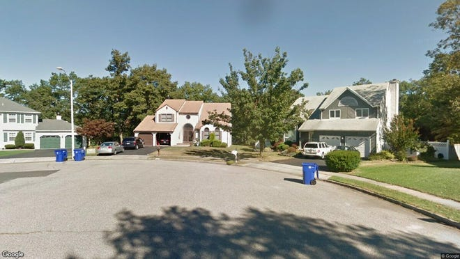 This Google Street View image shows the approximate location of 2067 Nakiska Court in Toms River. The property at this address changed hands in November 2019, when new owners bought the property for $442,500.
