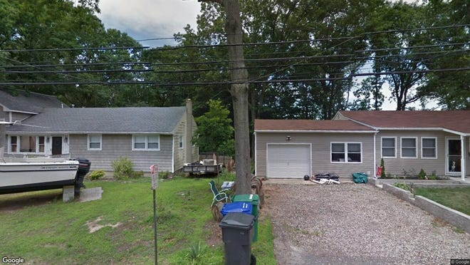 This Google Street View image shows the approximate location of 1908 Red Cedar St. in Toms River. The property at this address changed hands in December 2019, when new owners bought the property for $248,000.