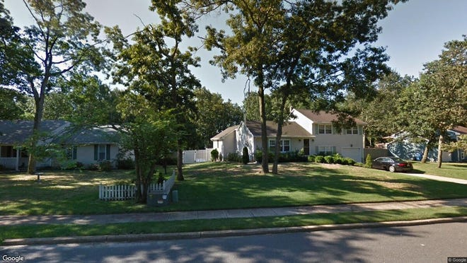 This Google Street View image shows the approximate location of 21 Ashford Road in Jackson. The property at this address changed hands in December 2019, when new owners bought the property for $435,000.