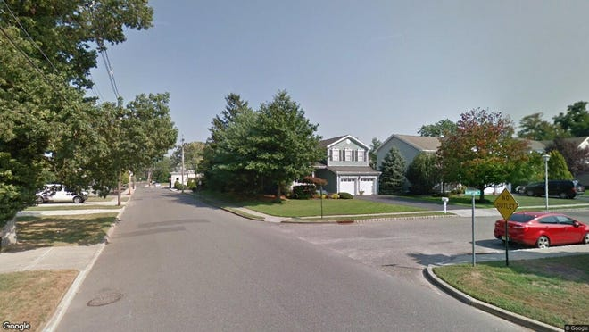 This Google Street View image shows the approximate location of 1 Hampton Court in Spring Lake Heights. The property at this address changed hands in December 2019, when new owners bought the property for $800,000.
