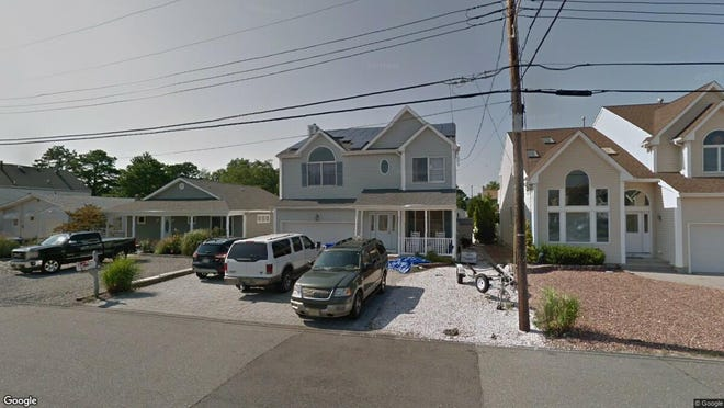 This Google Street View image shows the approximate location of 56 Jib Lane in Brick. The property at this address changed hands in December 2019, when new owners bought the property for $502,500.