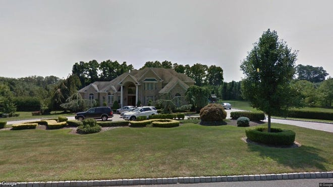 This Google Street View image shows the approximate location of 12 Maacka Drive in Holmdel. The property at this address changed hands in August 2019, when new owners bought the property for $1,399,900.