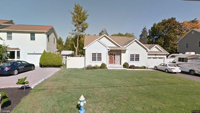 This Google Street View image shows the approximate location of 34 Oping Road in Pequannock. The property at this address changed hands in November 2019, when new owners bought the property for $580,000.