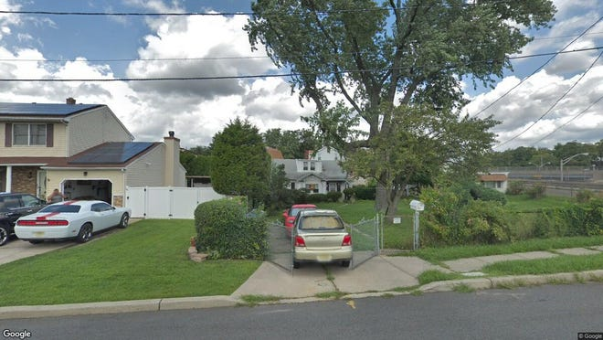This Google Street View image shows the approximate location of 12 Loretta St. in Woodbridge. The property at this address changed hands in December 2019, when new owner bought the property for $80,900.