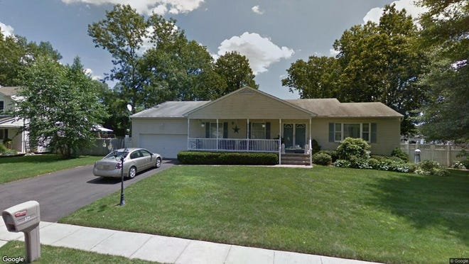 This Google Street View image shows the approximate location of 271 Duck Pond Lane in Brick. The property at this address changed hands in January 2020, when new owners bought the property for $365,000.