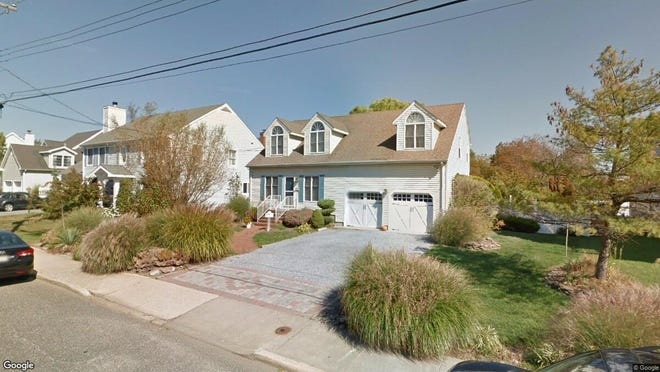 This Google Street View image shows the approximate location of 17 Hastings Place in Monmouth Beach. The property at this address changed hands in January 2020, when new owners bought the property for $715,000.