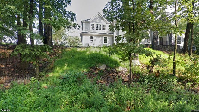 This Google Street View image shows the approximate location of 1353 Johnston Drive in Watchung. The property at this address changed hands in December 2019, when new owners bought the property for $875,000.