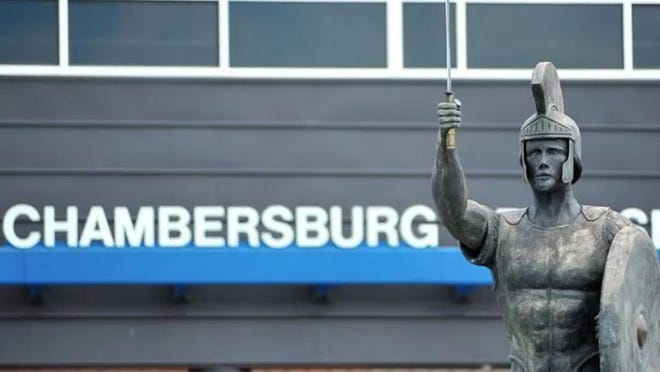 A Trojan soldier statue stands outside the entrance to Chambersburg Area Senior High School in 2013. Parents and the public are upset that they cannot speak during Chambersburg Area School District board meetings. FILE PHOTO