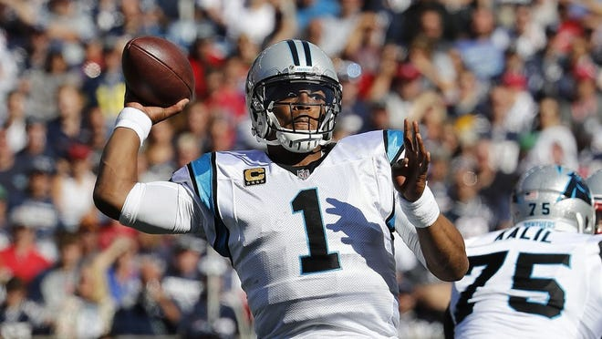 Carolina Panthers quarterback Cam Newton throws a pass during an Oct. 2017 game against the New England Patriots at Gillette Stadium in Foxborough.