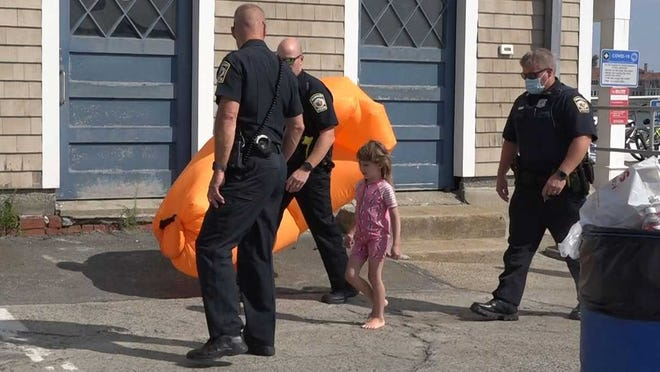 A young child was rescued from the water off a North Shore beach Tuesday after the raft she was floating on got blown out to sea, according to Marblehead police.