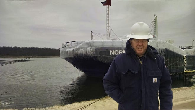 Bob Borowski prepares to board a tugboat for inspection. These inspections frequently happen during the winter months when they are laid up on the Great Lakes.