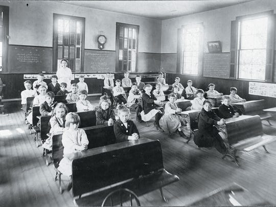 Class photo from the 1912-13 school year. Teacher:
