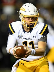 Toledo Rockets quarterback Logan Woodside (11) prepares to hand off the ball during the first half against the Western Michigan Broncos at Waldo Stadium on Nov. 25, 2016.