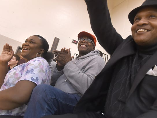 Marcia, left, and Horace Walker, center, cheer for