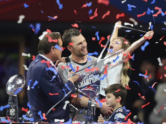Tom Brady and his daughter, Vivian, celebrate after