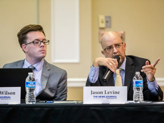 News Journal sports editor Jason Levine asks a question of candidates during the New Castle County Executive Debate at the Hockessin Memorial Hall in August 2016.