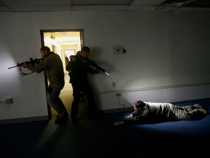 Members of the Farmington Police Department clear a