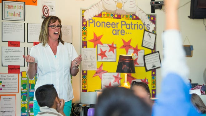 First-grade teacher Lisa Arganbright (Cq) in her classroom at Pioneer Elementary School in Glendale on Tuesday, April 23, 2013. She is one of the 2,000 teachers who have had their pay frozen for the past six years. Michael Schennum / The Arizona Republic