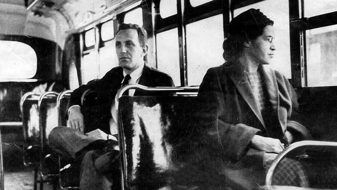 Rosa Parks riding on the Montgomery Area Transit System bus.