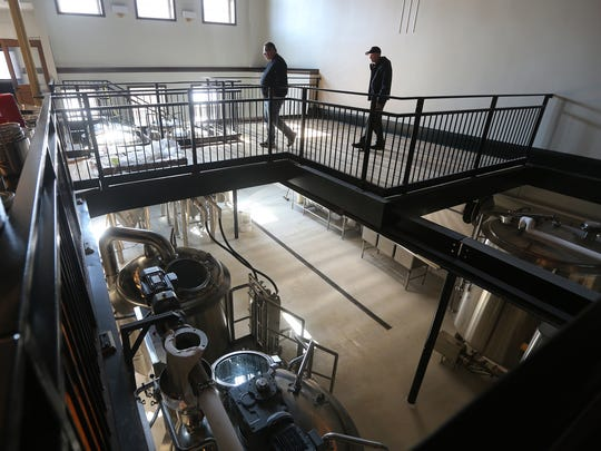 The brewing equipment at Eli Fish Brewing will be visible