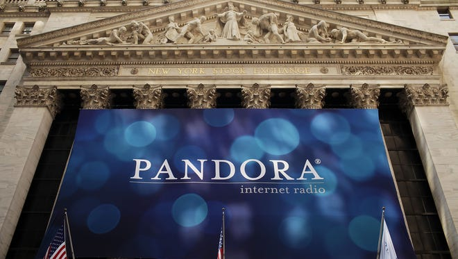 A banner for Pandora Media Inc., the online-radio company, hangs in front of the New York Stock Exchange walk on its first day of trading as a public company on June 15, 2011 in New York City.