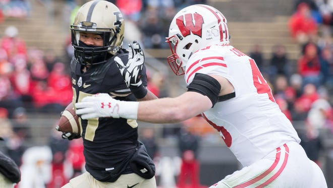 Purdue running back Brian Lankford-Johnson (37) runs the ball while Wisconsin linebacker Ryan Connelly (43) defends in the first quarter at Ross Ade Stadium.