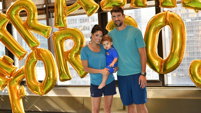 Nicole Phelps, Boomer Phelps and Michael Phelps attend the Huggies Little Swimmers Swim Class With The Phelps Foundation on Aug. 21 in New York.