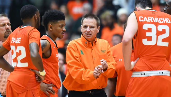 CSU men's basketball coach Larry Eustachy talks to his team during a timeout in a Feb. 25, 2017, win over San Diego State at Moby Arena.
