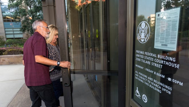 Kevin Northcraft and his wife Chris enter federal bankruptcy court Thursday, August 2, 2018 in Fresno for a hearing to discuss the agreement to reopen the Tulare hospital.