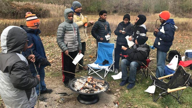Kids participate in the Sierra Club's Detroit Outdoors program at Scout Hollow in Rouge Park on the city's west side in 2017.
