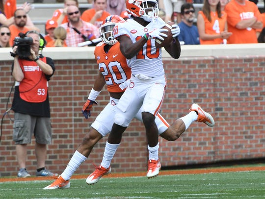 Clemson wide receiver Derion Kendrick (10) catches