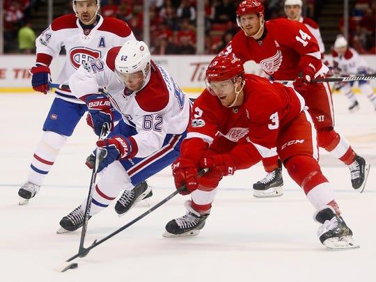 The Canadiens' Artturi Lehkonen battles for the puck with Red Wings defenseman Nick Jensen on Monday, Jan. 16, 2017 at Joe Louis Arena.