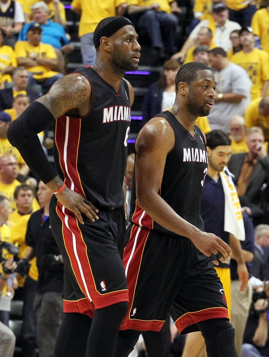 Dwyane Wade, LeBron James do it all in fourth for Heat