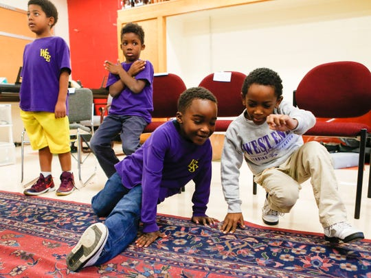 Kobe Payne, left, and Elijah Dishman dance during music therapy class at the West End School. School officials hope the music class will help students deal with trauma and stressors of home life. Nov. 7, 2016