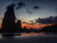 A peaceful sunset colors the sky at Cannon Beach, Ore.,