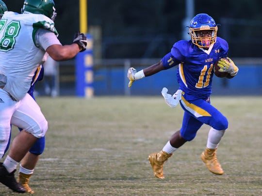Wren senior Tyrese Franklin (11) runs near Easley players during the first quarter at Wren High School in Piedmont on Friday.