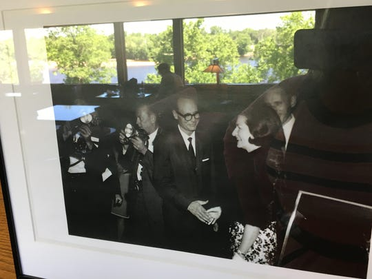 The Wisconsin River is reflected in glass covering a black-and-white photograph taken by Robert Hartmann of First Lady Lady Bird Johnson's visit to The Spring Green Restaurant in 1967. The building now is home to the Frank Lloyd Wright Visitor Center, which serves as the starting point for tours of Wright's nearby home, Taliesin.