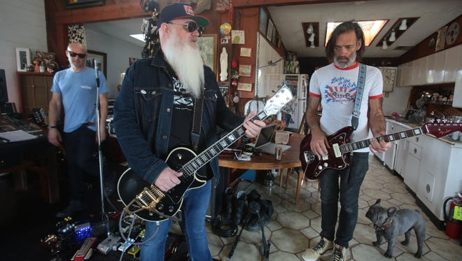 Dave Catching owner of Rancho de la Luna studio, center, with Earthlings? singer Pete Stahl, left, and bass player Brain O'Connor practice at Rancho de la Luna in March. Catching will join in a benefit for O'Connor Saturday at Pappy and Harriet's
