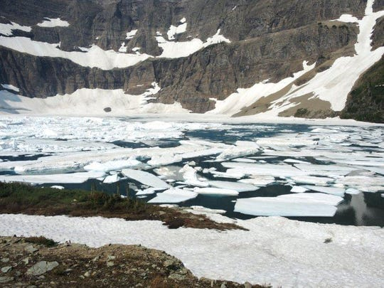 At the right time of year, icebergs can been seen floating on Glacier's Iceberg Lake.
