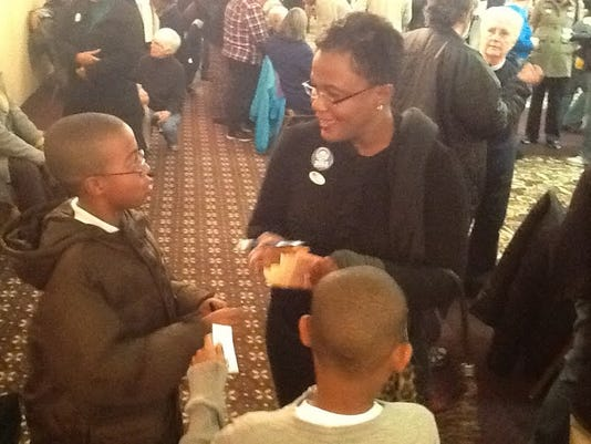 York Mayor Kim Bracey stops during a gathering on Election Night to sign autographs for two young pulls who pulled her aside and asked.