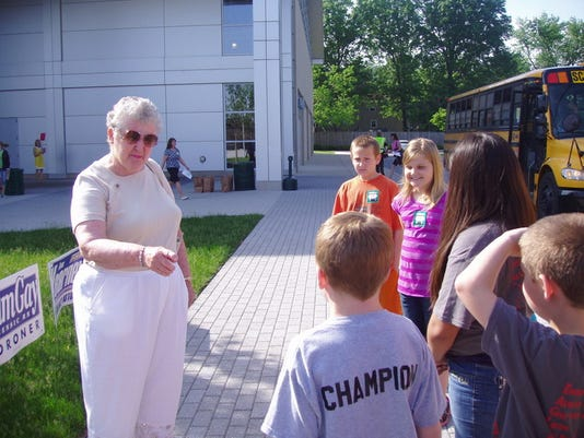 Jan Snyder greets students as they arrive at a health and safety fair hosted by York Hospital Auxiliary at York College. (Submitted photo)