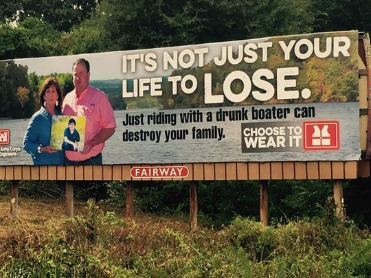 Sandy and Bill Varner, of Texarkana, hold a picture of their son, Trey, for a billboard sponsored by the Arkansas Game and Fish Commission to promote the dangers of boating while intoxicated. Trey was killed in a boating accident in 2013 with a drunk operator at the controls.
