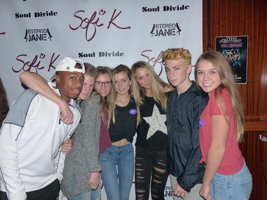 Bloomfield Hills High students (from left) Justin Mathis, Darren Mack, Sydney Petoskey, Ellie Getz, Jade Neumann, Jacob Werthman and Mckenna Stachel were on hand to see fellow students Sofi K and Stereo Jane perform.