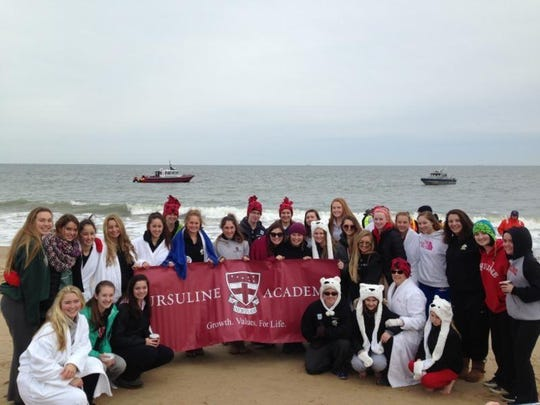Ursuline Academy's Polar Bear Plunge team, The Frosty Raiders, took a dip in the ocean to raise money for Special Olympics.